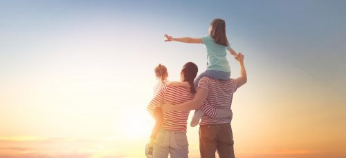 happy family at sunset celebrating financial planning success dreaming about future